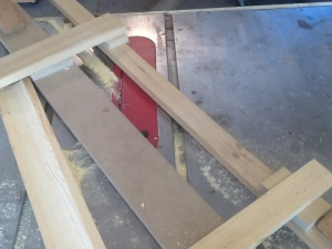 Simple tablesaw jig to cut the cove in the wood